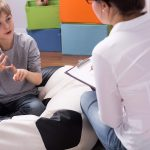 happy speech therapist working with student