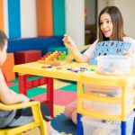 special education teacher strategies used with a patient in a classroom